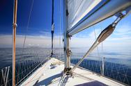 Stock Photo of sailboat yacht sailing in blue sea. tourism