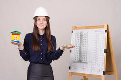 girl advertises multi-storey building under construction - stock photo