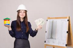 Stock Photo of girl offers to invest in construction of houses