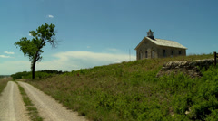 Flint Hills school house and road in Kansas Stock Footage