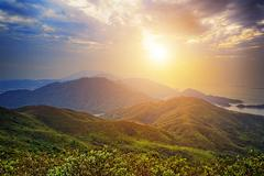 Stock Photo of Beautiful summer landscape in the mountains with the sun at dawn