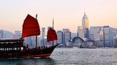 Traditional wooden sailboat / tourist junk sailing in Victoria Harbour ,Hong Kon - stock photo