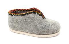 Single traditional Austrian grey felt slipper - stock photo