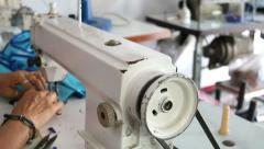 Stock Video Footage of Closeup shot of sewing machine with the hands of a tailor