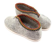 Two traditional grey felt slippers posed heel to toe Stock Photos