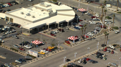 HELICOPTOR FLYING OVER AUTO MALL Stock Footage