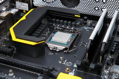 Modern computer processor and motherboard Stock Photos