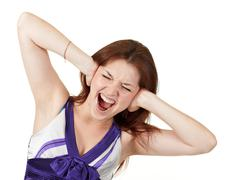 young screaming girl holding her head - stock photo