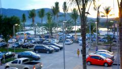 Parking in the shopping center at sunset overlooking lake and palm trees. Stock Footage