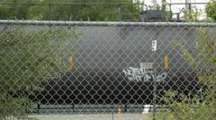 Train, graffiti, chain link fence, railroad, 4K, UHD Stock Footage