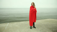 Stock Video Footage of Sad lonely woman in red blanket on the pier. Sea.