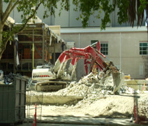 TRACTORS TEAR DOWN BUILDING TIME LAPSE #1 Stock Footage
