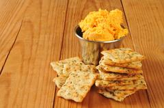 Stock Photo of Herbal flatbread crackers with cheese spread