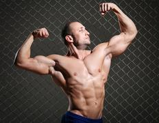 Fitness. Beautiful, strong man and his muscles Stock Photos