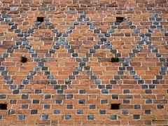 Mosaic brick facade Stock Photos
