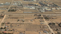 HELICOPTER FLYING OVER DESERT FREEWAY AND BUILDINGS Stock Footage