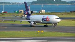 FedEx airplane arrives at the airport Stock Footage