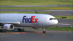 FedEx jet plane taxies after landing Stock Footage