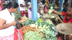 Young local woman selling and people buying at Hikkaduwa market. Stock Footage