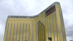 Mandalay Bay Hotel and Casino Las Vegas with tilt down Stock Footage