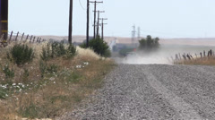 Truck driving on dusty road, drought Stock Footage