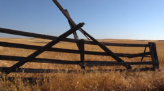 Broken gate and golden wheat Stock Footage