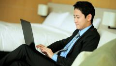 Male Ethnic Asian Chinese Relaxing Luxury Hotel Laptop Social Media Stock Footage