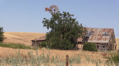 Abandoned ranch, barn and windmill, lonely Stock Footage