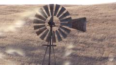 Farm, Windmill pumping dust, wild oats Stock Footage