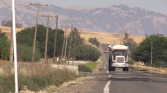 big rig semi truck on country road - stock footage