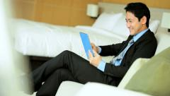 Asian Chinese Businessman Leisure Hotel Accommodation Tablet Device - stock footage