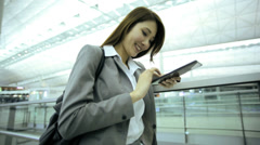 Female Asian Chinese Airport Flight Passenger Business Meeting Mini Tablet Stock Footage