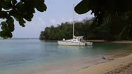 Stock Video Footage of catamaran anchored at exotic tropical bay