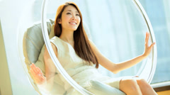 Asian Chinese Female Relaxation Designer Chair Luxury Apartment Lifestyle Stock Footage