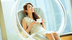 Successful Ethnic Female Drinking Coffee Luxury Home Modern Furnishings - stock footage