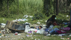 Homeless Man Sorts Through Trash for Valuables Stock Footage