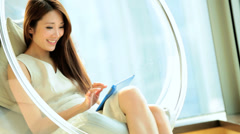 Young Asian Chinese Woman Leisure Luxury Room Tablet Corporate Hospitality Stock Footage