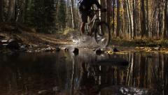 Mountain Biking Through Water Stock Footage