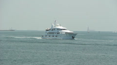 Cabin Cruiser Passes Lighthouse Stock Footage