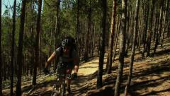 Mountain Biking Through Pine Forest Stock Footage
