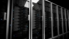 Data center servers glass fronted flashing lights tracking shot centre Stock Footage