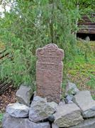Mil stone in Skansen park (Sweden) - stock photo