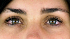 Closeup of beautiful green eyes Stock Footage