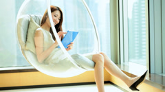 Asian Chinese Female Relaxation Modern Chair Tablet Luxury Apartment Lifestyle Stock Footage