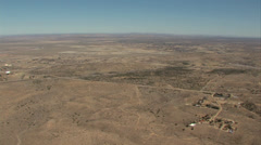 HELICOPTER FLYING OVER SPARSLEY POPULATED DESERT Stock Footage