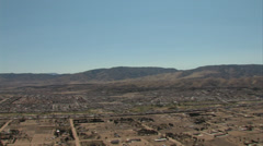 HELICOPTER FLYING OVER HIGH DESERT AND HOMESI Stock Footage