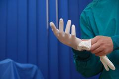 surgery sterile gloves - stock photo