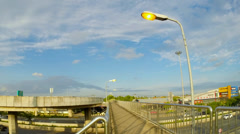 Street light pole with a blue sky background. Time lapse Stock Footage