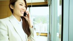 Ethnic Female Financial Advisor Travel Hotel Room Smart Phone Communication - stock footage