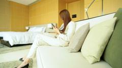 Female Ethnic Asian Chinese Corporate Executive Luxury Hotel Smart Phone - stock footage